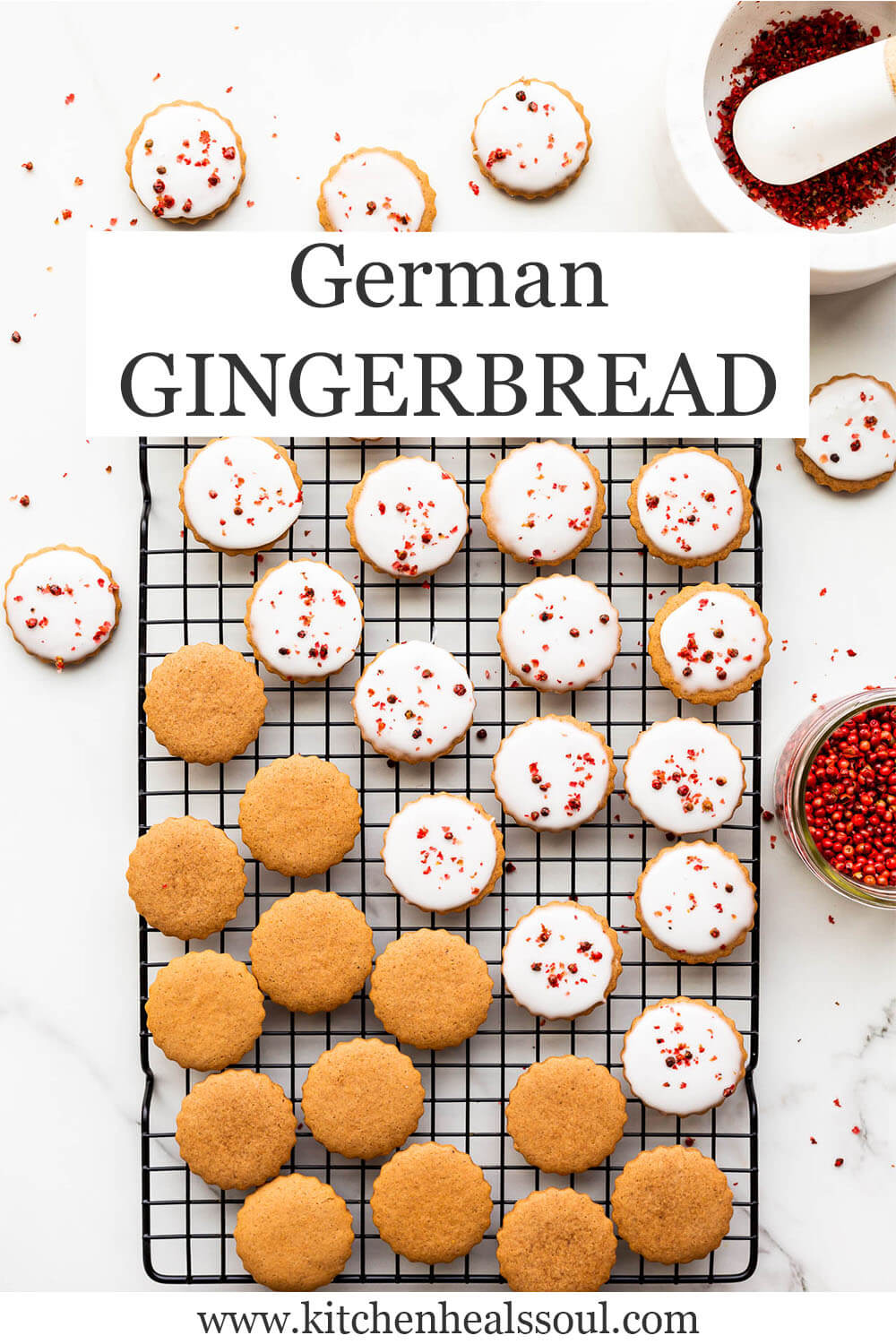 German gingerbread on a cooling rack in the process of being glazed with icing.