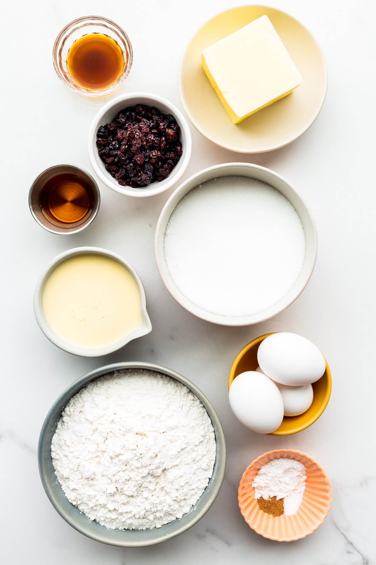 Ingredients to make eggnog pound cake in a bundt pan, measured out and ready to be mixed