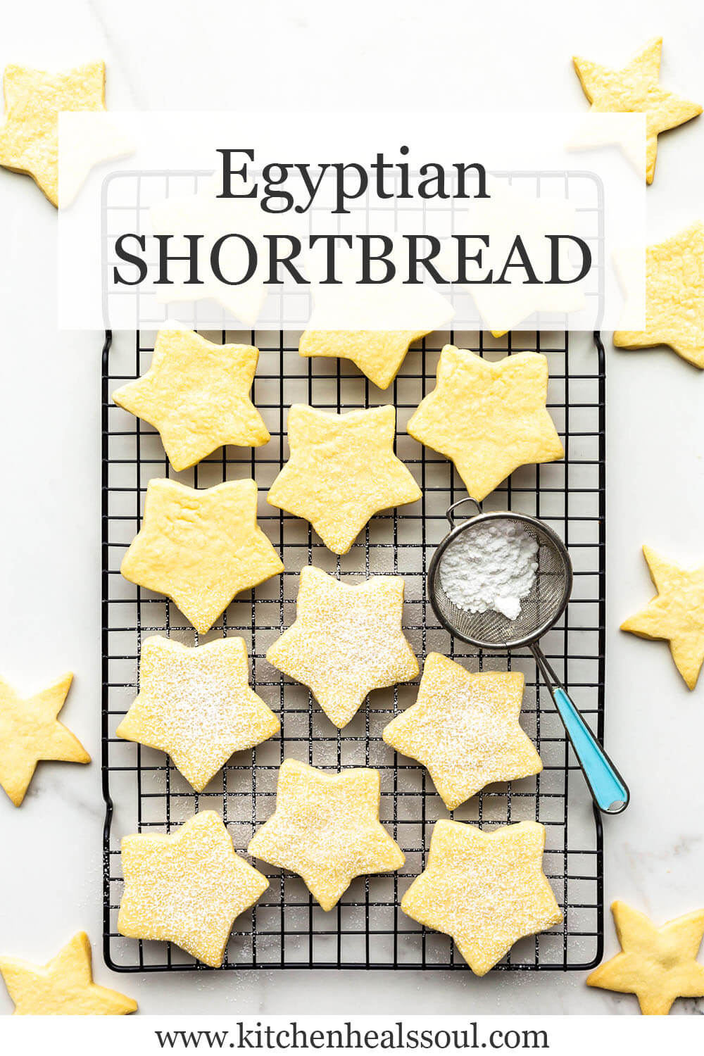 Star cookies on a black cooling rack being sprinkled with icing sugar.