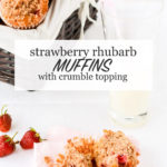 A basket of strawberry rhubarb muffins with crumble topping with a glass of milk and a muffin sliced open with fresh strawberries