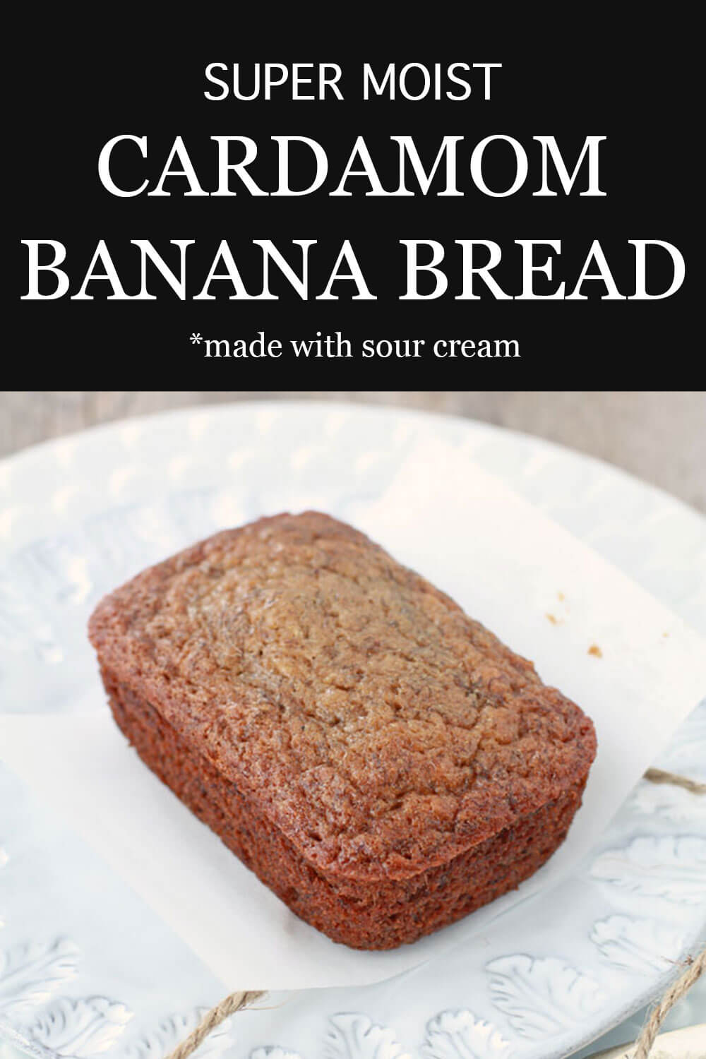 super moist mini cardamom banana bread loaf cake on a plate which was wrapped in parchment paper and tied with twine