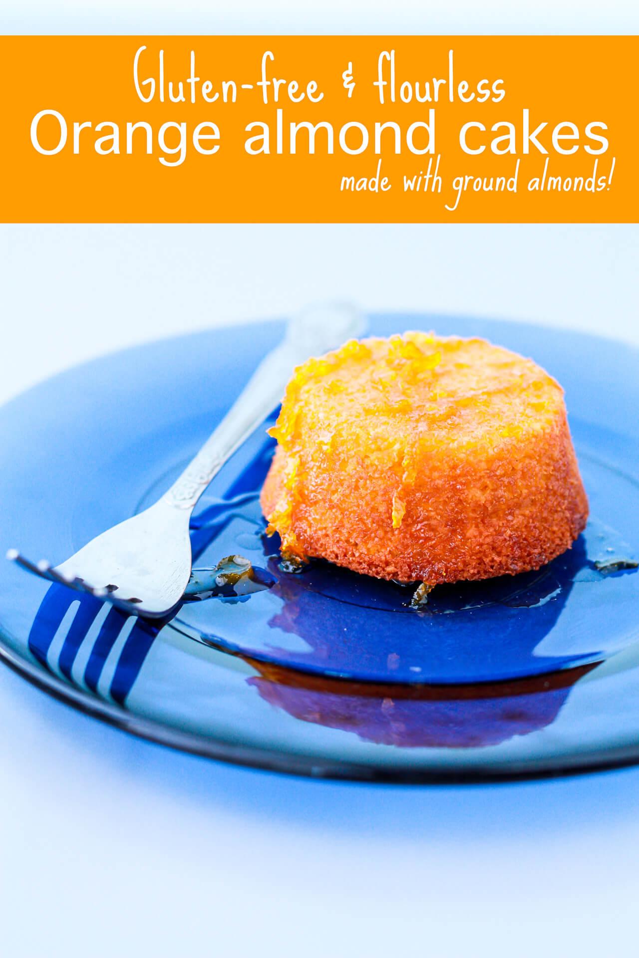 Little orange cake with orange zest syrup served on a blue plate with a fork, backlit food photo