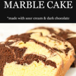 Slices of chocolate and vanilla marble loaf cake arranged on a white platter