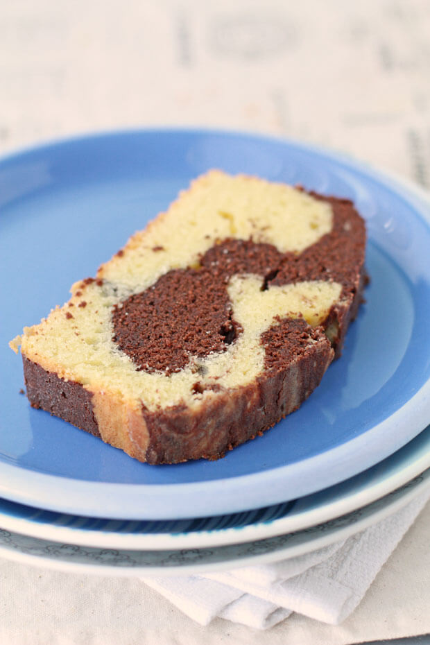 Chocolate and vanilla marble cake on a blue plate