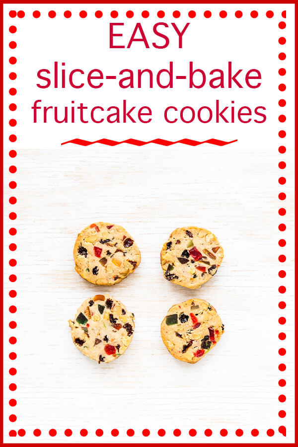 Slice-and-bake fruitcake cookies text with 4 round fruitcake cookies baked golden brown and featuring red cherries, green cherries, raisins, and chopped nuts