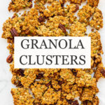 Homemade granola clusters broken into big pieces on parchment paper