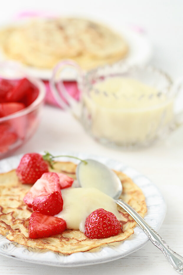 Homemade crepes with strawberries and vanilla pastry cream