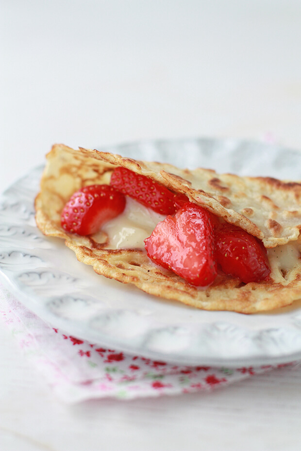 crepes with vanilla pastry cream and fresh strawberries