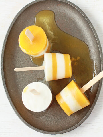 Coconut Mango popsicles made from sweetened coconut milk and mango juice
