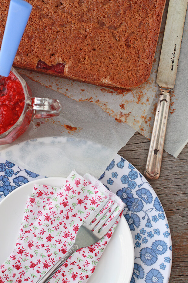 Gluten free cake served with fresh raspberry compote