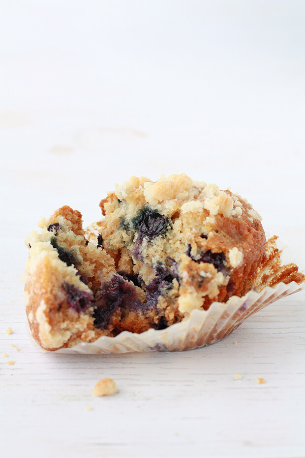 Honey blueberry muffin with crumble topping opened up to show inside