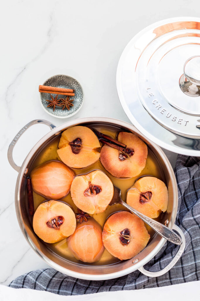 Poached quince in a rondeau pan from Le Creuset.