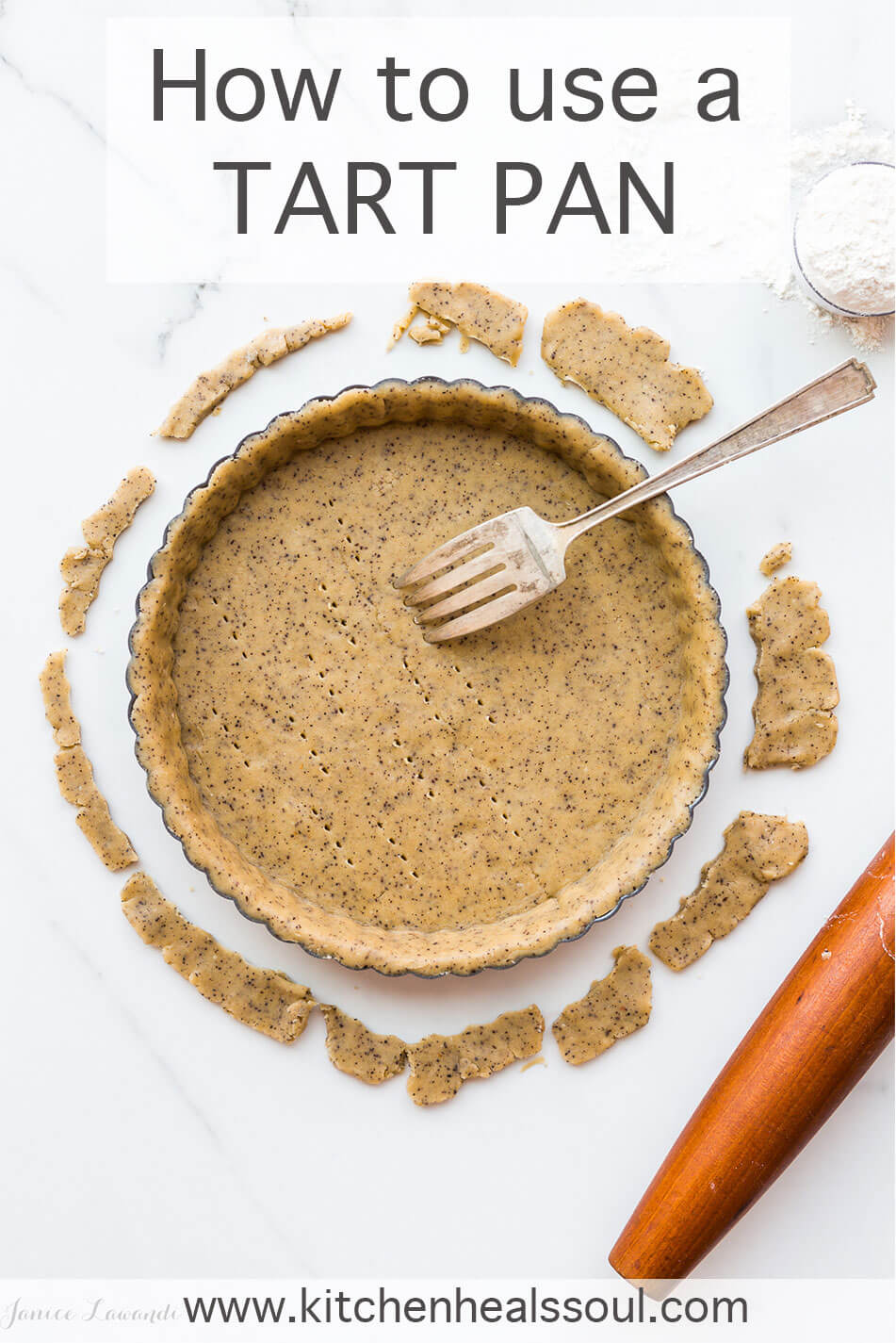 A tart pan with tart dough fitted inside and a fork to prick the pastry to allow air and steam to escape during blind baking