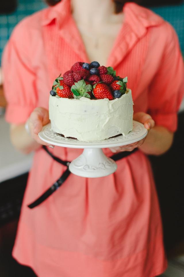 Janice Lawandi holding a cake