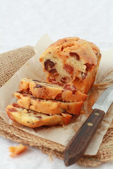 chorizo date loaf sliced with serrated knife to serve