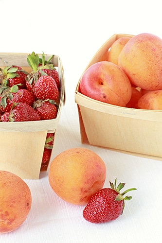 Baskets of strawberries and apricots
