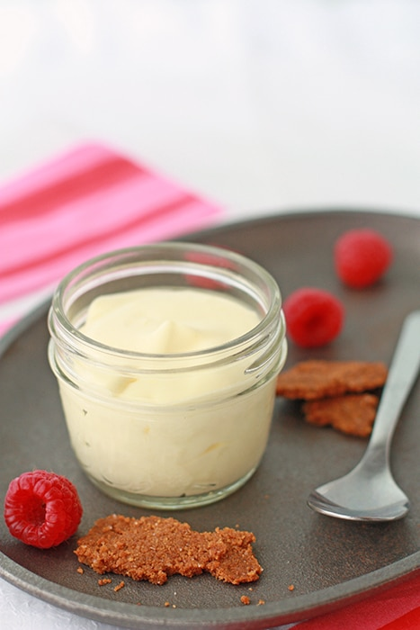 Lemon mousse served in a small jar with graham cracker crumble and berries