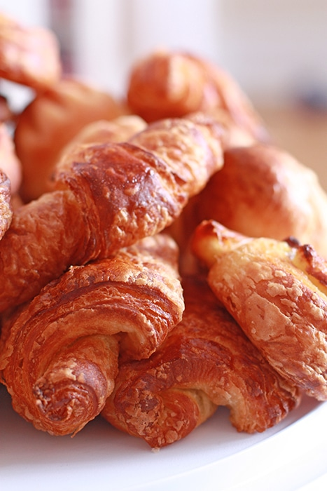 A platter of golden brown, flaky viennoiseries.