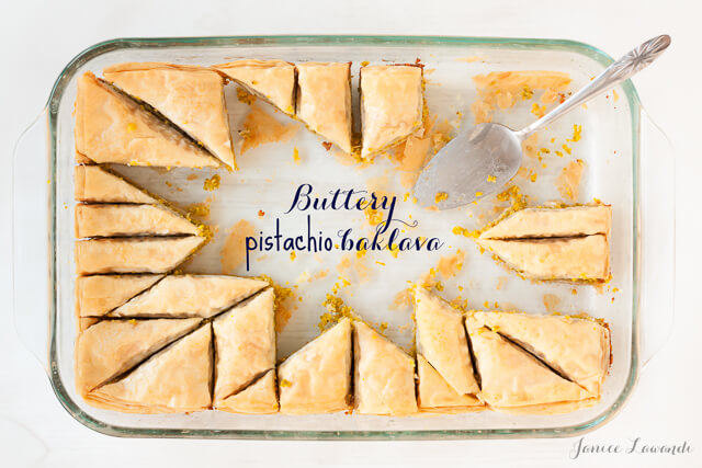 Pistachio baklava cut into a star pattern with two thirds of the pieces removed