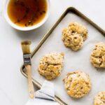 Bourbon-maple glazed cheddar bacon biscuits | www.kitchenhealssoul.com