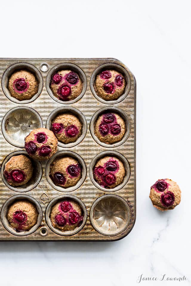 Baked cranberry chestnut financiers in a decorative vintage pan