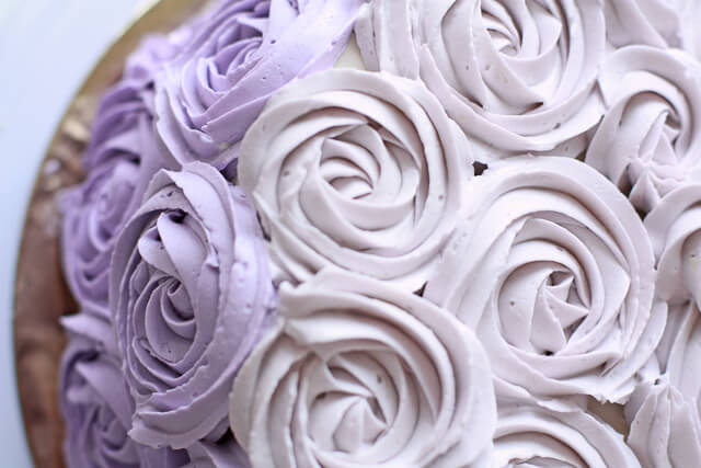 Piped Italian meringue buttercream to make a rose cake