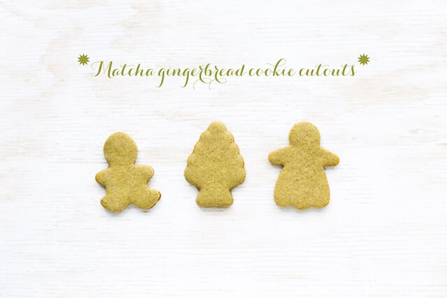 Three matcha gingerbread cookies, cutout in shapes of a boy, a tree, and a girl.