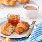 Croissant breakfast - homemade croissants with marmalade