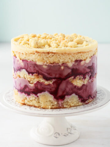 Milk crumbs on a Momofuku Milk Bar style cake-layers of blackberry curd, almond cake, and almond frosting
