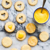 Sandwiching coconut cookies with grapefruit curd