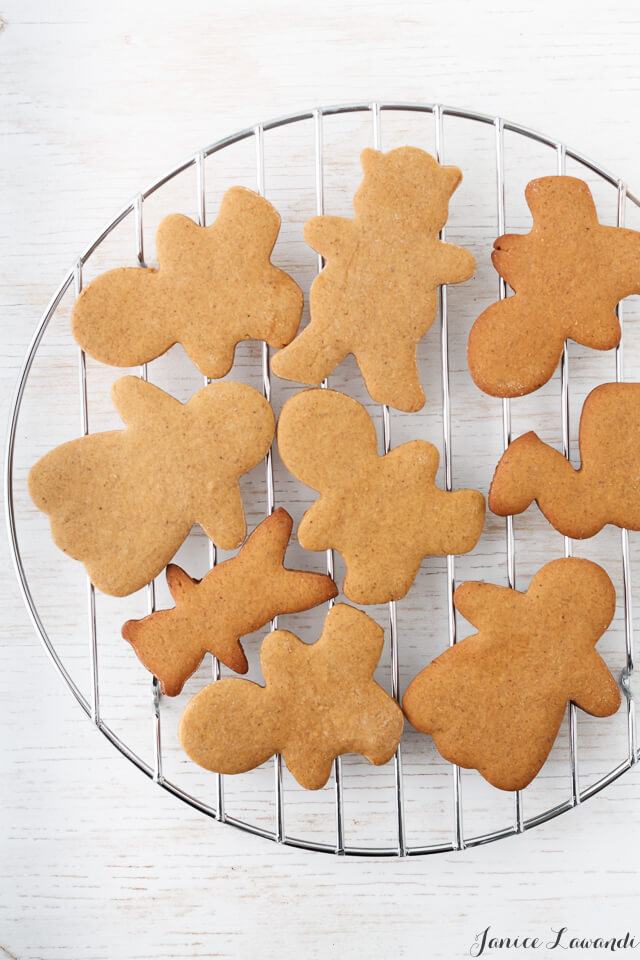 Gingerbread cookie cutouts on a cooling rack.