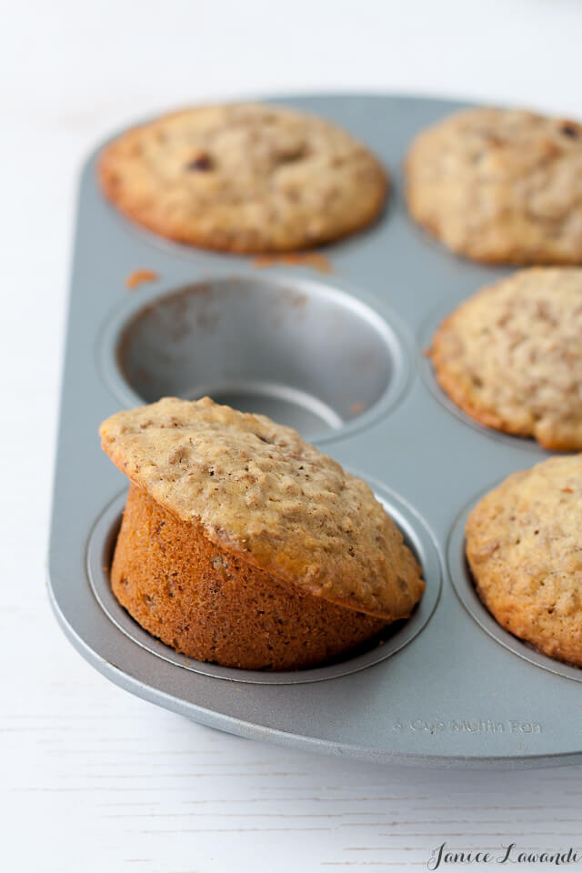 homemade date bran muffins in a muffin pan with 1 cup empty