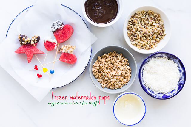 Frozen watermelon pops dipped into melted chocolate, granola, nuts, coconut and other fun toppings