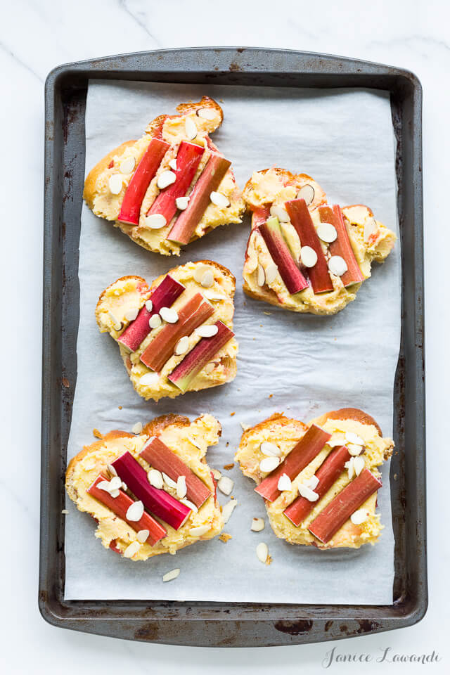 Orange blossom rhubarb bostocks are made from frangipane and baked in the oven until golden brown