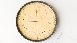 Dock shortbread by poking holes with a metal skewer or a fork to allow steam to escape so shortbread can dry properly in the oven