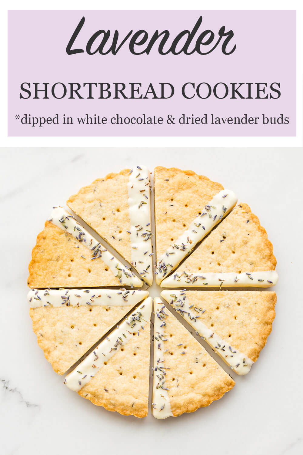 lavender shortbread cookies baked in a fluted tart pan for a scalloped edge, then cut into wedges and dipped in white chocolate and lavender buds