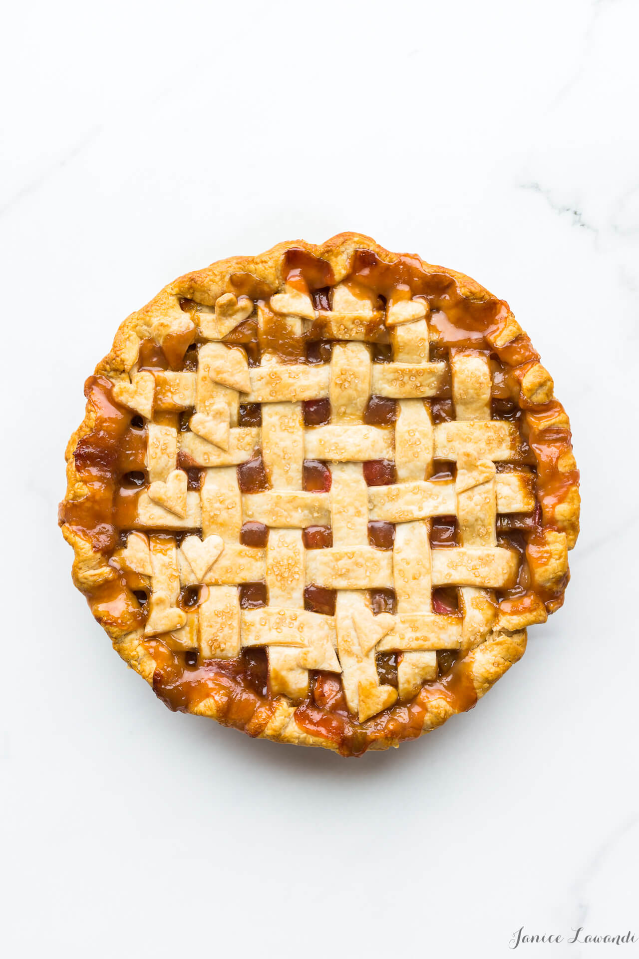 Homemade rhubarb pie with a lattice pie crust and heart cutouts
