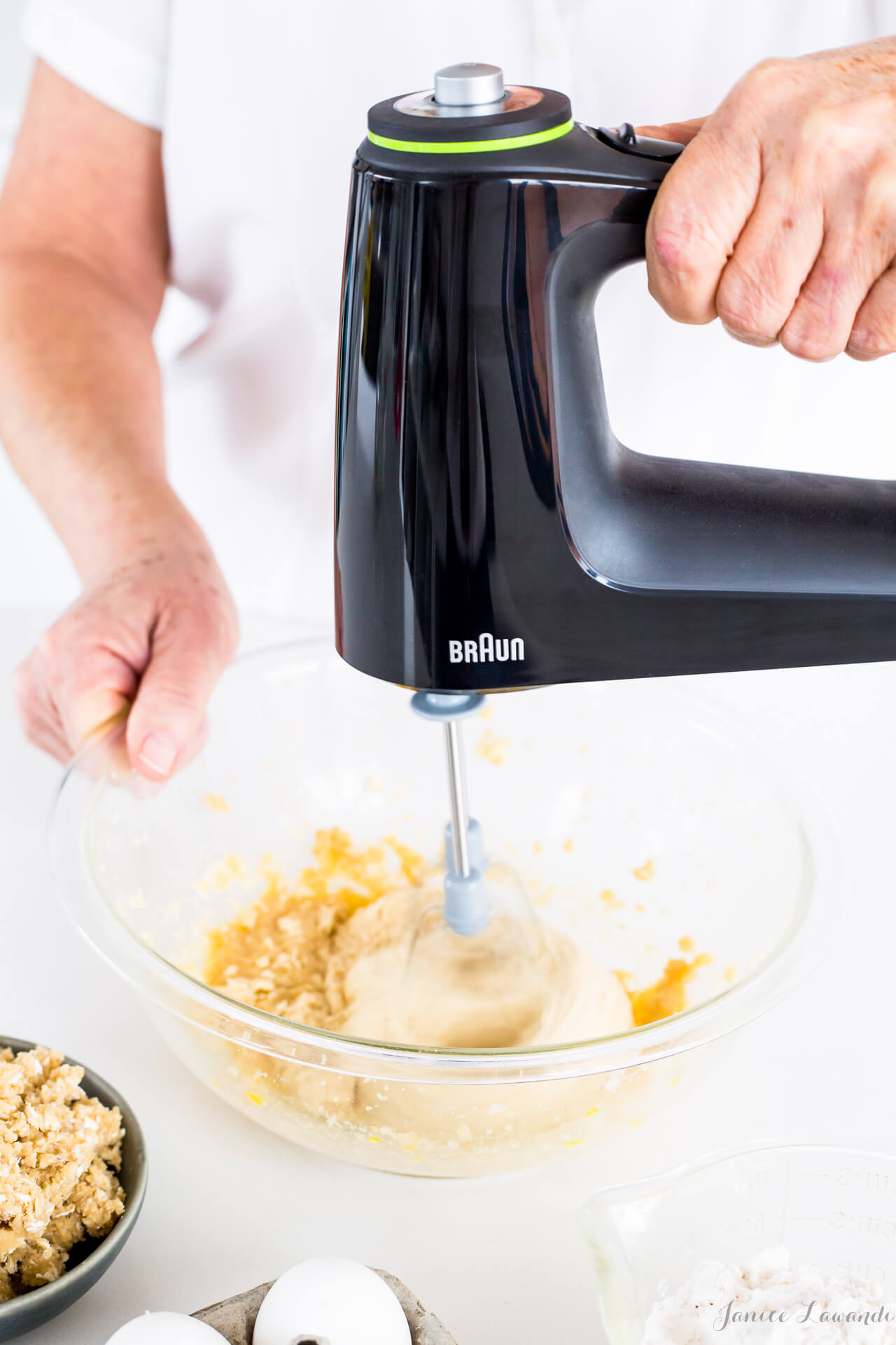 Mixing cake batter with a hand mixer—Alternating wet and dry ingredients to make cake