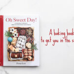 Book cover of Oh Sweet Day! baking book with a gift box filled with a variety of homemade cookies