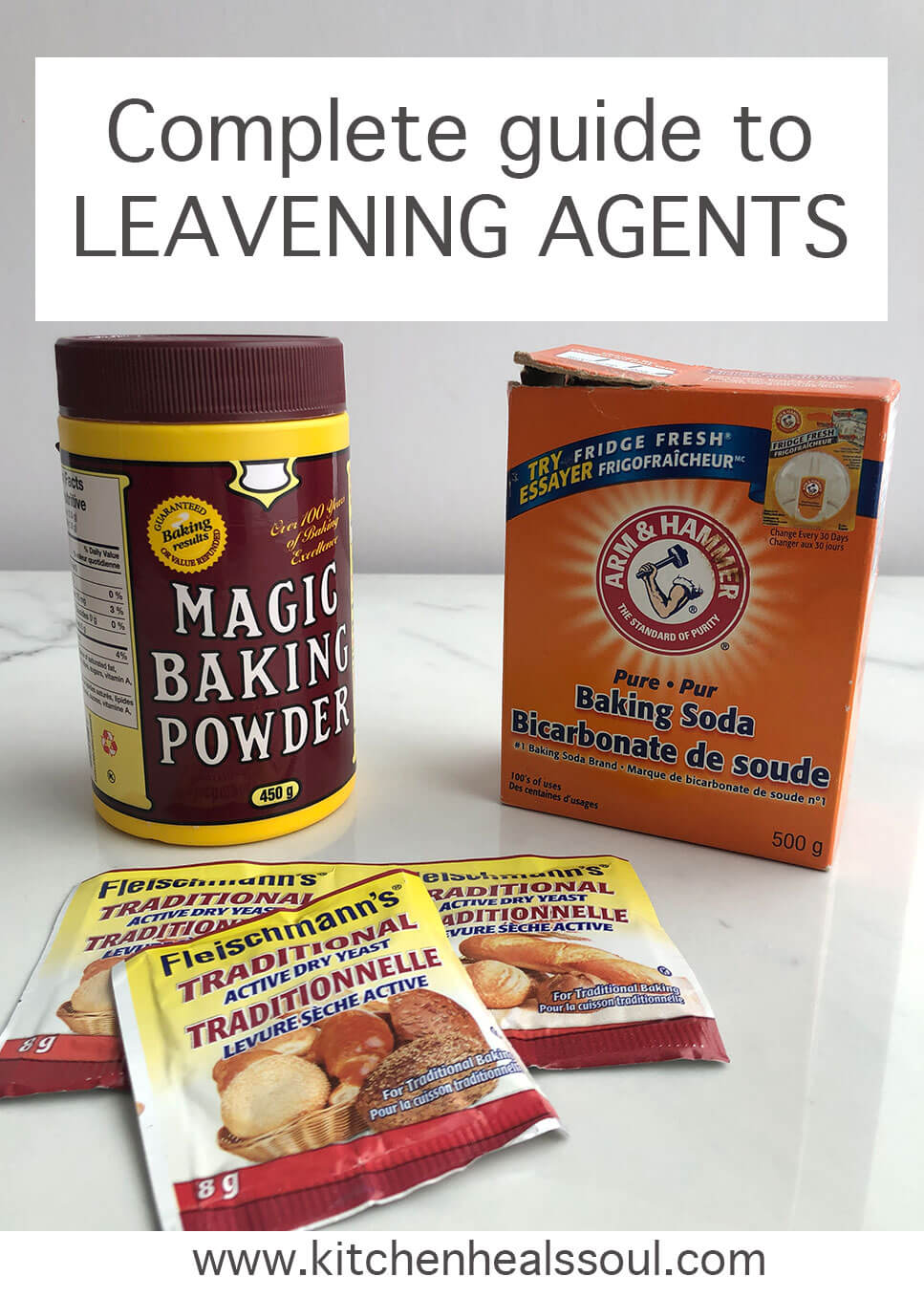 Burgundy and yellow container of Magic baking powder, an orange box of Arm & Hammer baking soda, and packets of Fleischman's traditional yeast