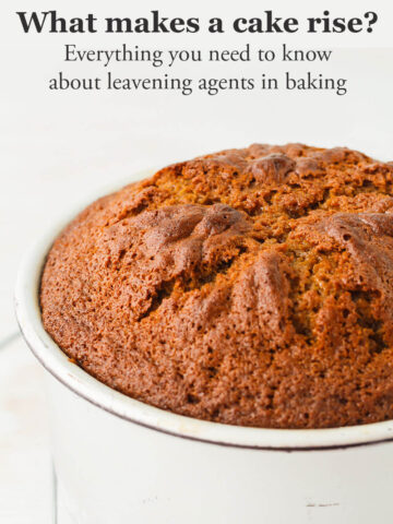 A golden brown spice cake that is domed and cracked on top and baked in a tall cake pan