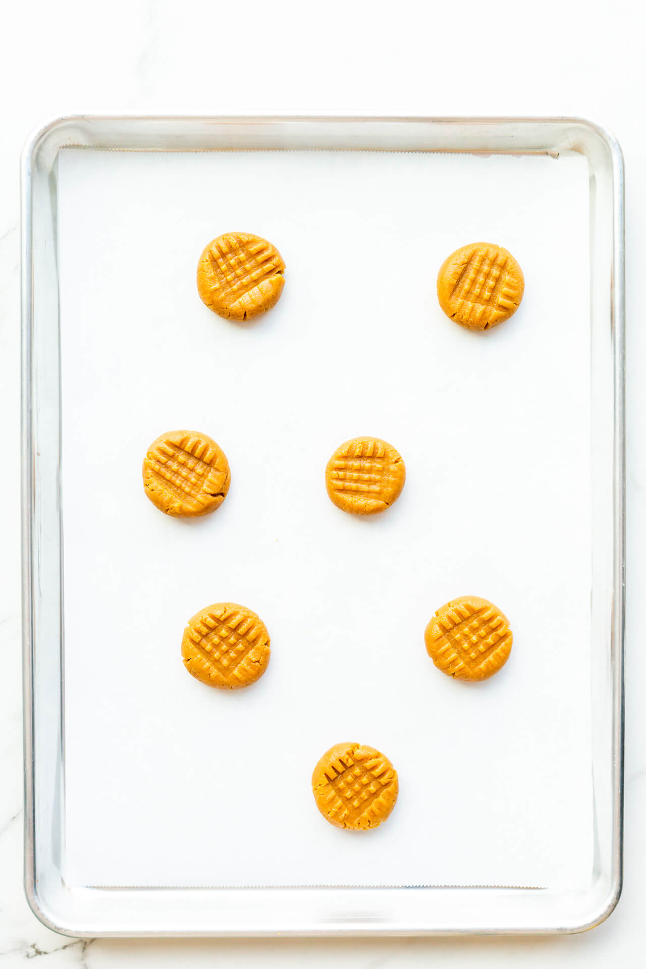 Flourless peanut butter cookies with criss cross pattern