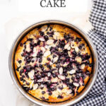 Black currant cake in springform with black and white checkered linen