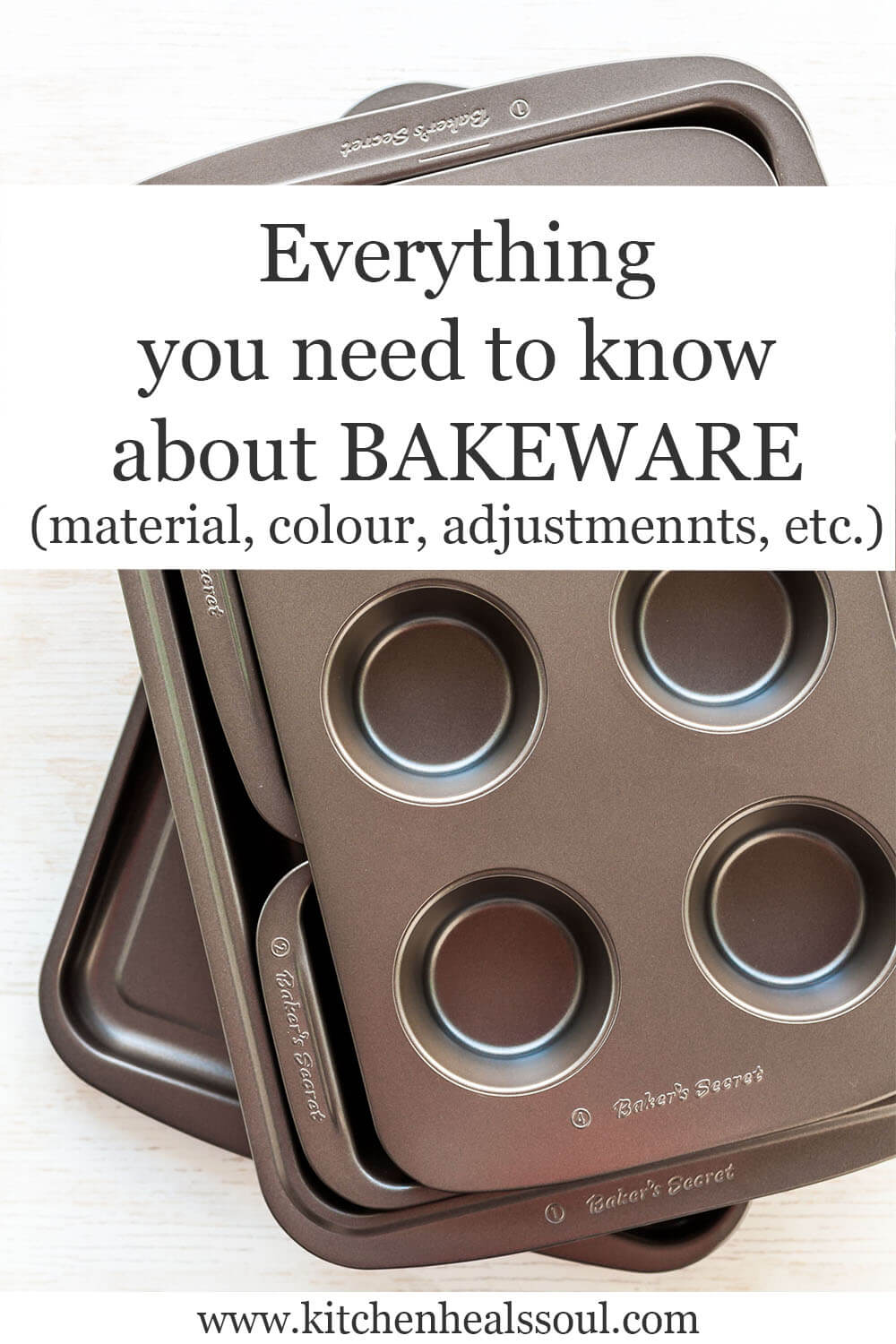 A stack of bakeware including muffin pan and loaf pan and sheet pan