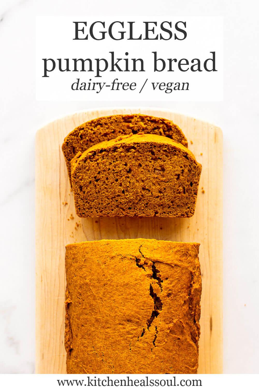 Sliced eggless pumpkin bread on wood cutting board