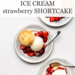 Ice cream strawberry shortcakes with biscuits on dessert plates