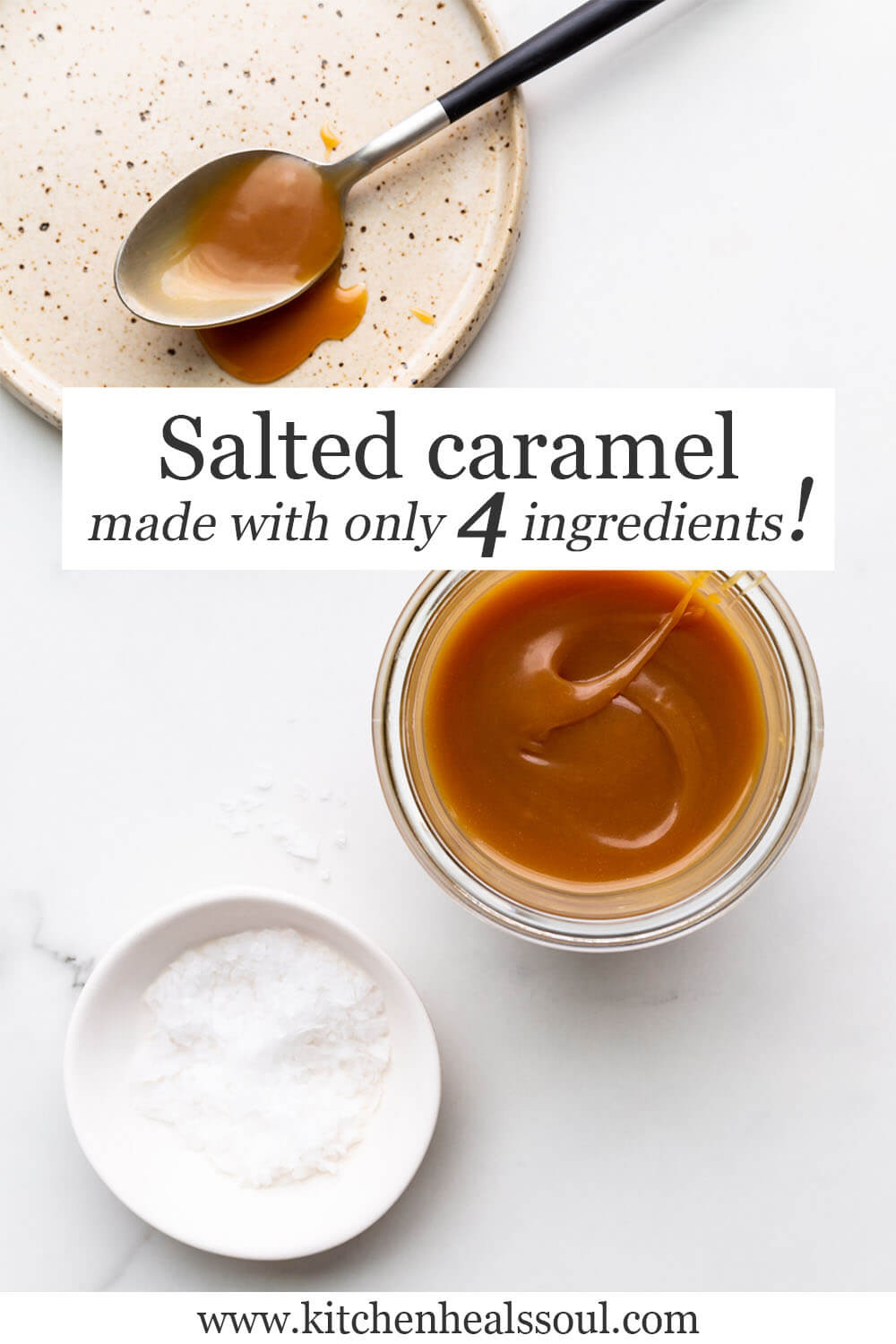 A jar of homemade salted caramel sauce made from only 4 ingredients, with a little bowl of flaky sea salt on the side and a ceramic plate with a spoonful of caramel