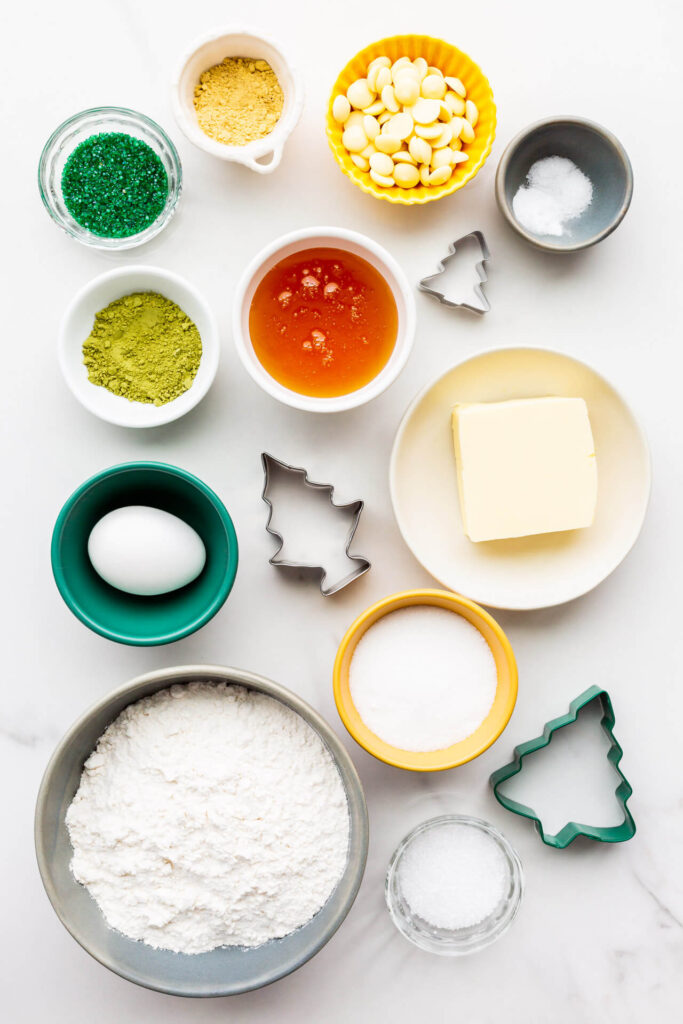 Ingredients and cookie cutters to make matcha cookies measured out and ready for baking.