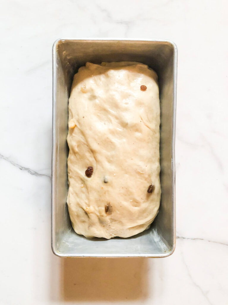 Stollen bread in loaf pan before baking.