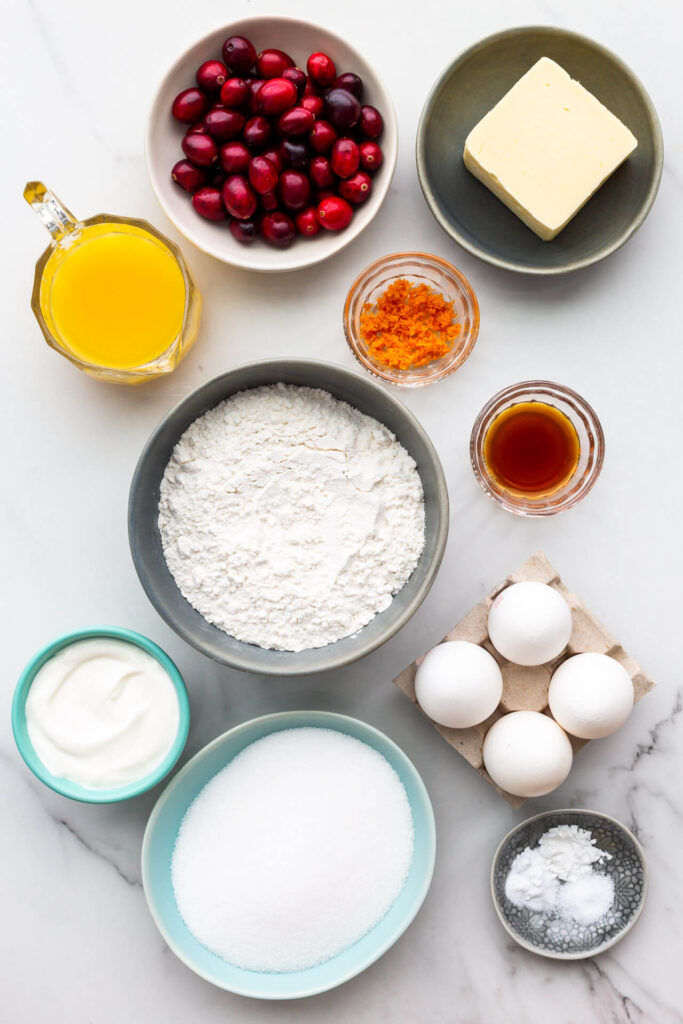 Ingredients for orange cranberry cake with sour cream measured out and ready to be mixed.